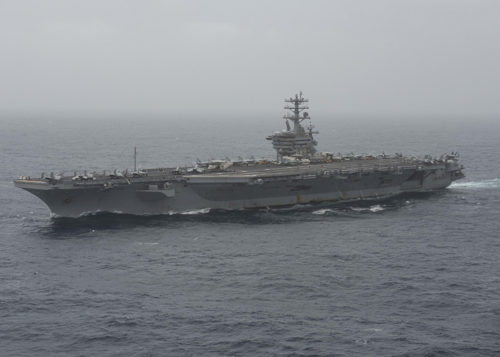In this photo released by the U.S. Navy, the aircraft carrier USS Nimitz transits the Arabian Sea on Aug. 17, 2020. The U.S. Navy searched through the...