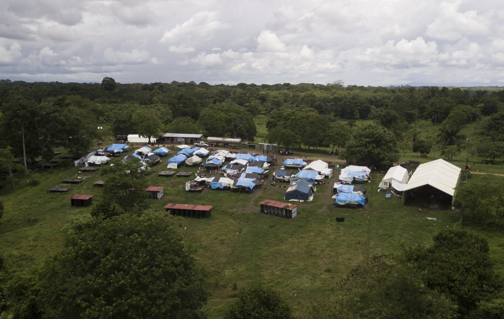 The Lajas Blancas migrant camp stands, amid the new coronavirus pandemic in Darien province, Panama, Saturday, Aug. 29, 2020. The camp is in a grassy ...