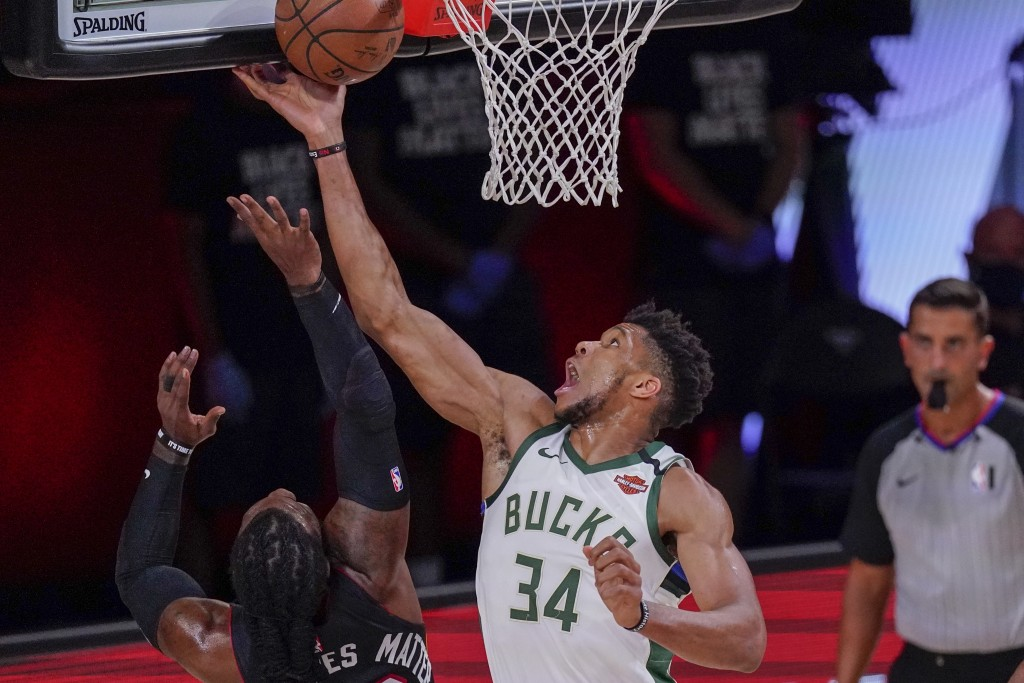 Milwaukee Bucks' Giannis Antetokounmpo tries to shoot past Miami Heat's Jae Crowder during the first half of an NBA conference semifinal playoff baske...