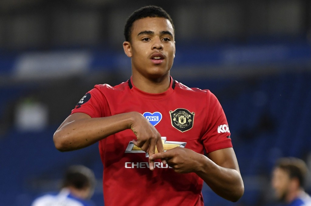 FILE - In this Tuesday, June 30, 2020 file photo, Manchester United's Mason Greenwood celebrates after scoring the opening goal of his team during the...