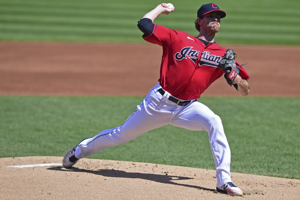 Cleveland Indians starting pitcher Shane Bieber delivers during the first inning of a baseball game against the Milwaukee Brewers, Sunday, Sept. 6, 20...