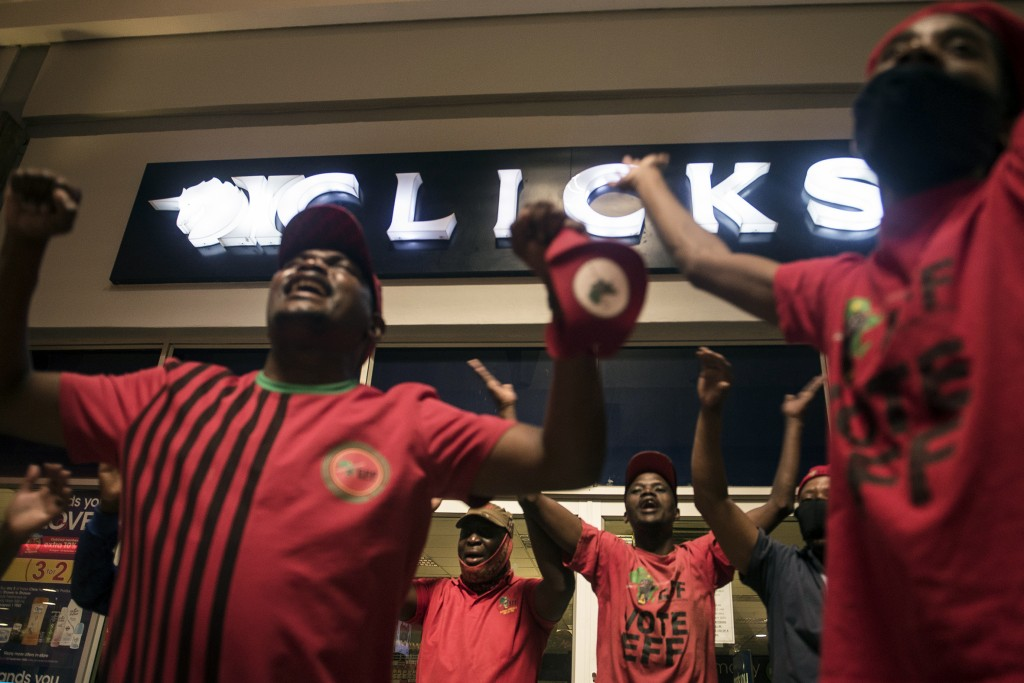 Economic Freedom Fighters (EFF) supporters protest outside a Clicks store in Soweto, Johannesburg, Monday, Sept. 7 2020 calling for the closure of the...