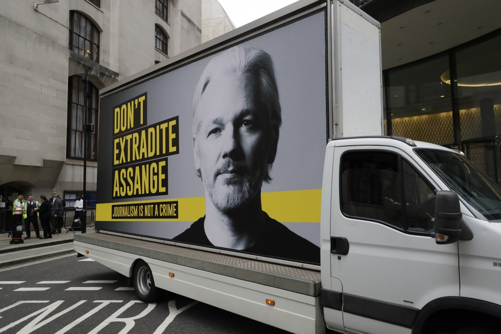 A billboard truck depicting Julian Assange drives past the Central Criminal Court Old Bailey in London, Tuesday, Sept. 8, 2020. Lawyers for WikiLeaks ...