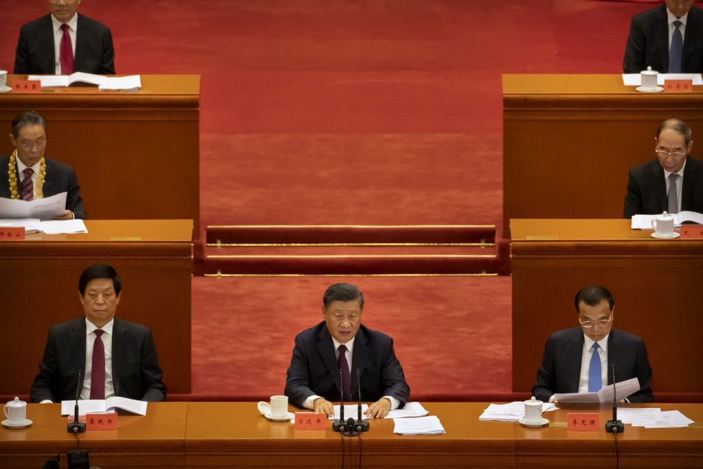 Chinese President Xi Jinping speaks during an event to honor some of those involved in China's fight against COVID-19 at the Great Hall of the People ...