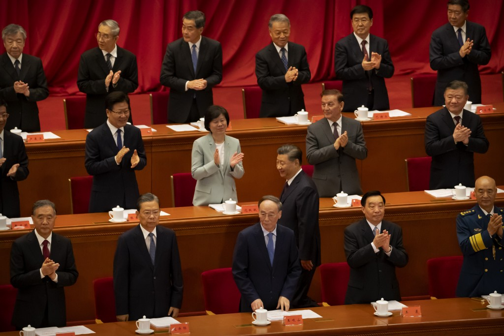 Attendees applaud as Chinese President Xi Jinping walks to his seat at an event to honor some of those involved in China's fight against COVID-19 at t...