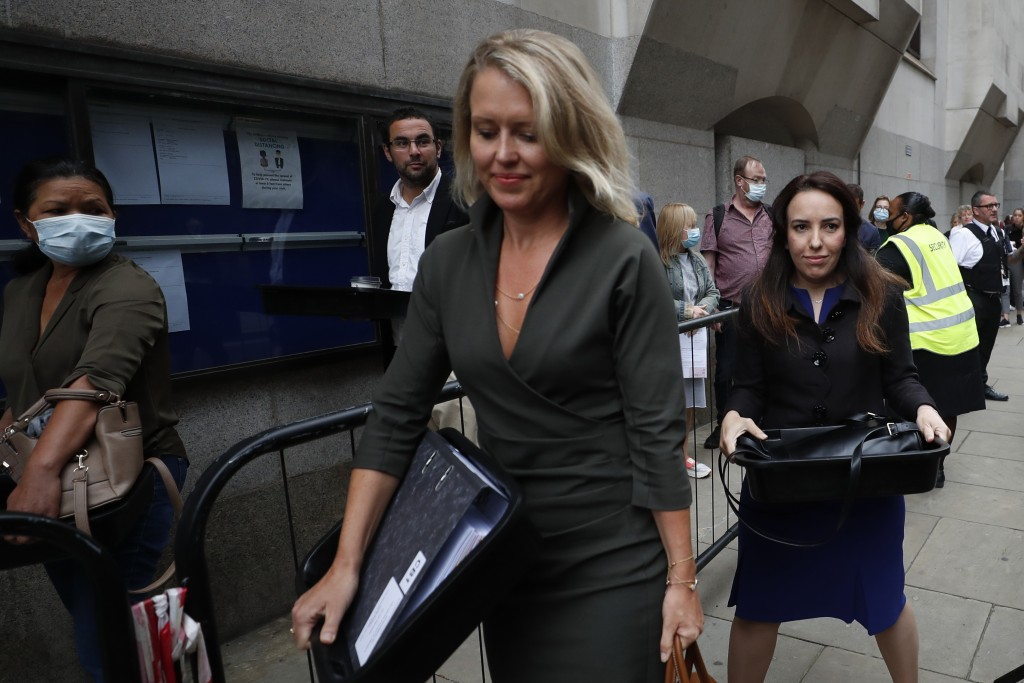 Julian Assange's lawyer Jennifer Robinson, center, and Assange's partner Stella Moris, right arrive to the Central Criminal Court Old Bailey in London...