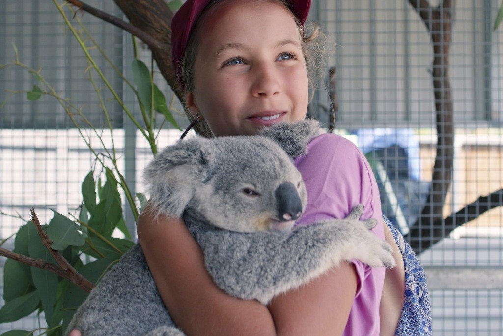 """This image released by Netflix shows Izzy Bee holding a koala bear in a scene from """"Izzy's Koala World,"""" which follows an 11-year old girl as she help..."""