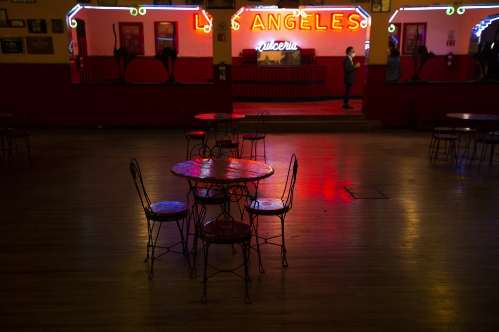 """Tables and chairs sit the empty Salon Los Angeles during an event to raise money and keep open the iconic dance hall known as """"The Cathedral of Mambo""""..."""