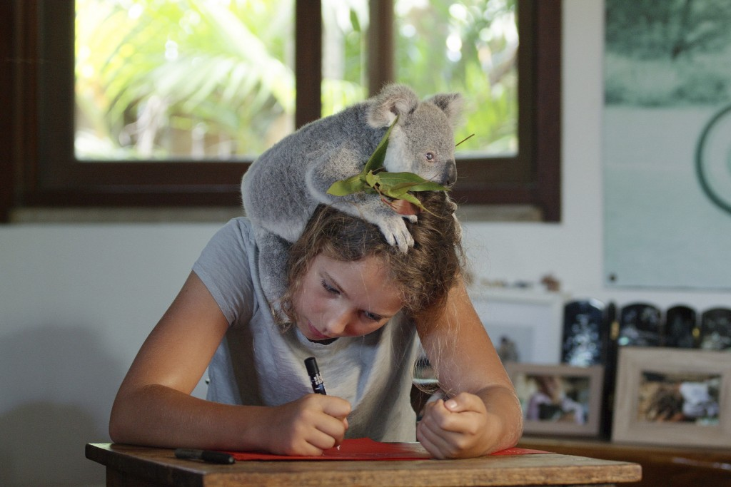 """This image released by Netflix shows Izzy Bee with a koala bear in a scene from """"Izzy's Koala World,"""" which follows an 11-year old girl as she helps h..."""