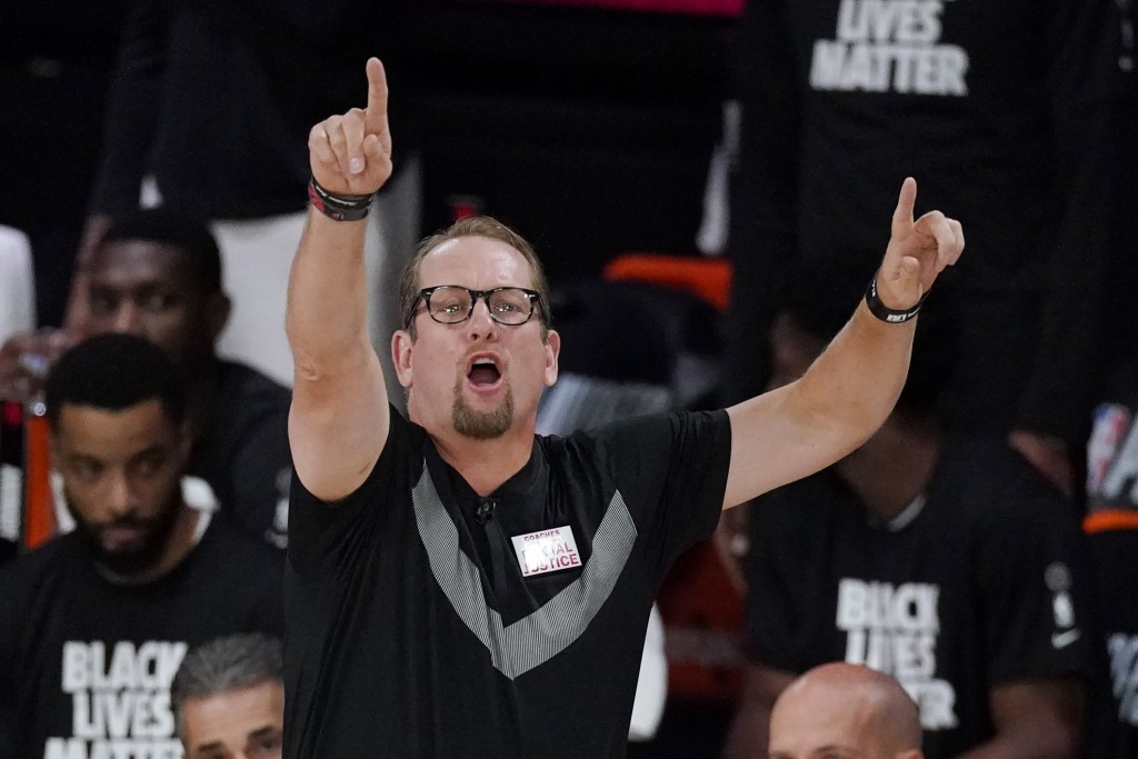 Toronto Raptors' head coach Nick Nurse directs his team during the first half of an NBA conference semifinal playoff basketball game with the Boston C...