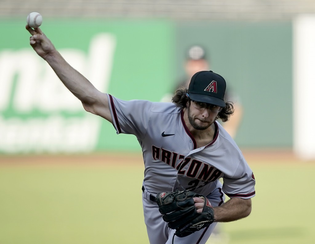 Arizona Diamondbacks starting pitcher Zac Gallen throws against the San Francisco Giants during the second inning of a baseball game on Monday, Sept. ...