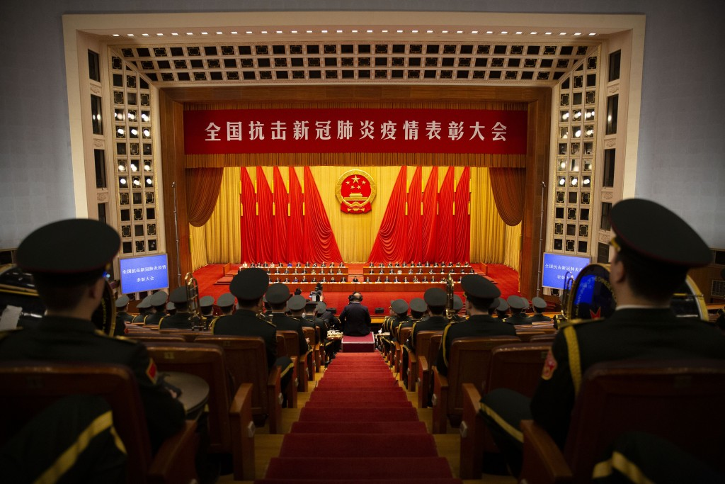 Members of Chinese military band watch an event to honor some of those involved in China's fight against COVID-19 at the Great Hall of the People in B...