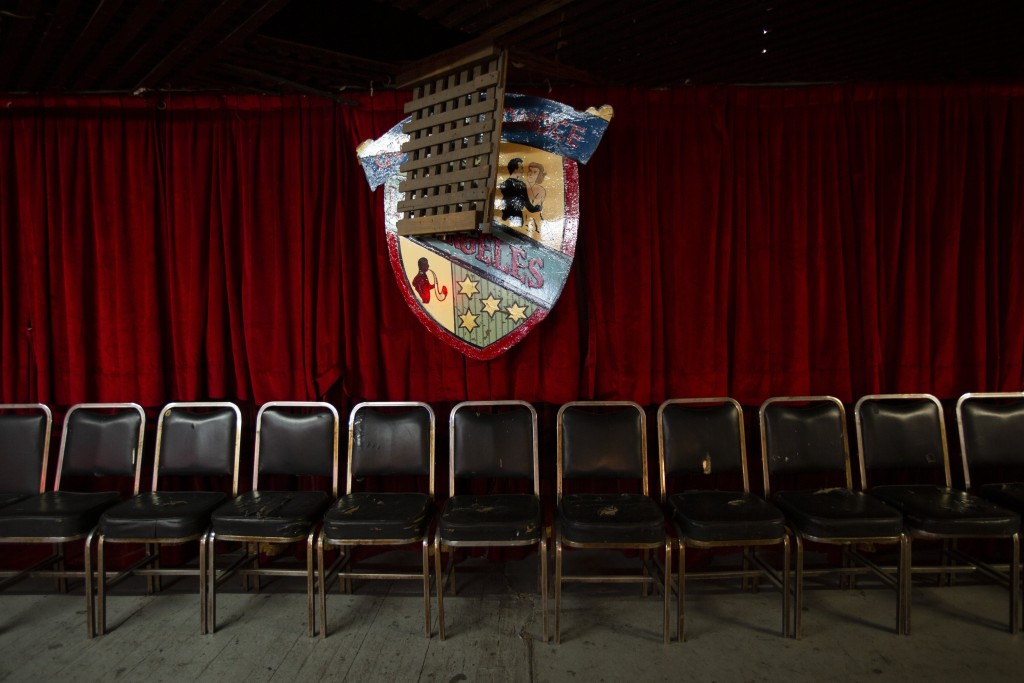 """Chairs are lined up under the coat of arms of the Salon Los Angeles during an event to raise money and keep open the iconic dance hall known as """"The C..."""