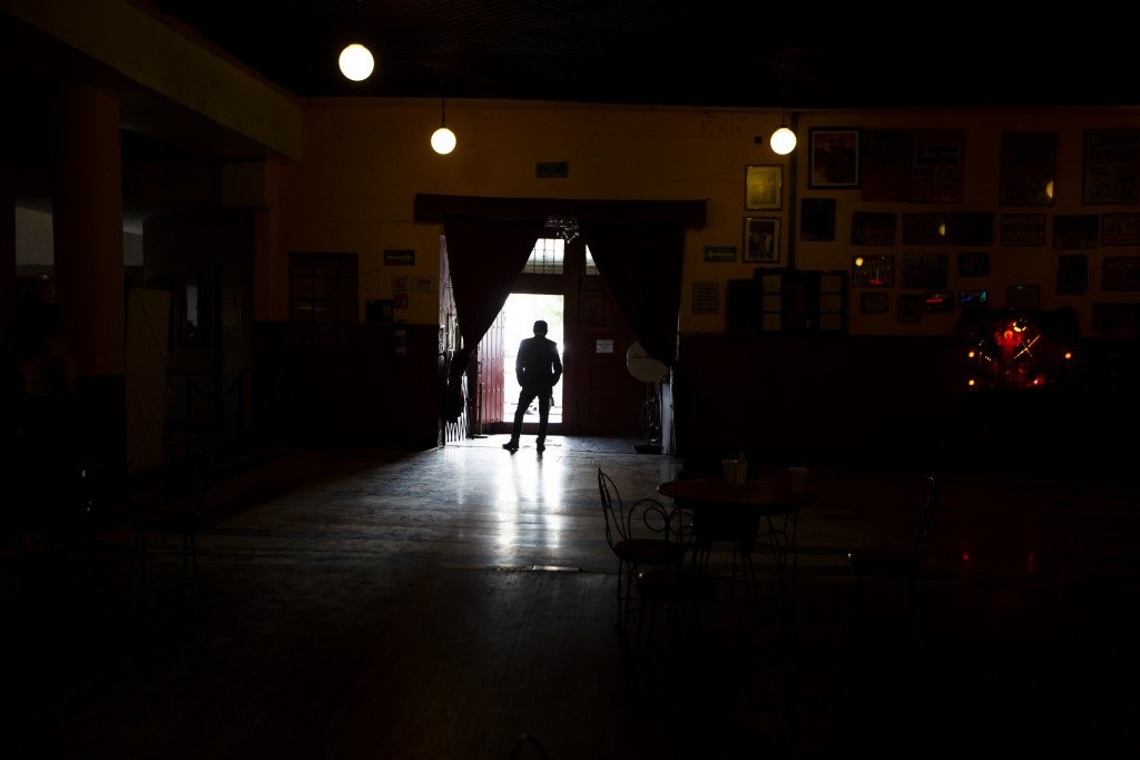Miguel Nieto, the owner of Salon Los Angeles, waits at the entrance for people to attend an event to raise money and keep open the iconic dance hall k...