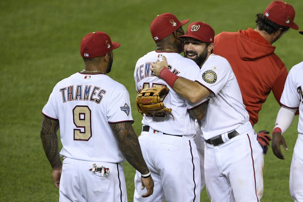 Washington Nationals' Adam Eaton, front right, hugs Howie Kendrick after a baseball game against the Tampa Bay Rays, Tuesday, Sept. 8, 2020, in Washin...