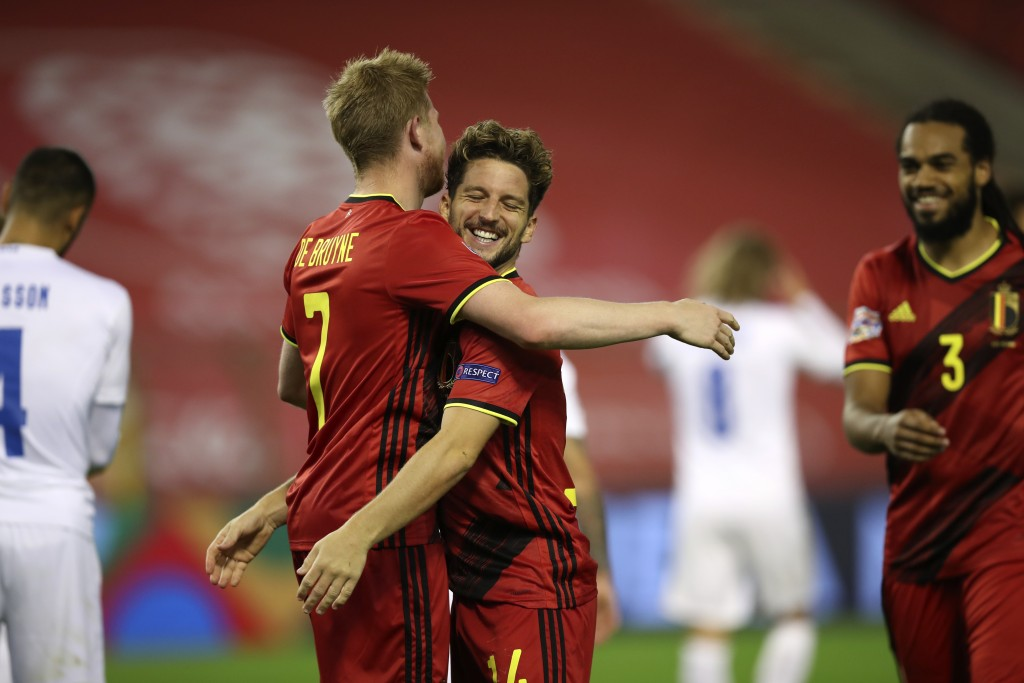 Belgium's Dries Mertens, center right, jubilates with Belgium's Kevin De Bruyne, center, left, after scoring his sides third goal during the UEFA Nati...