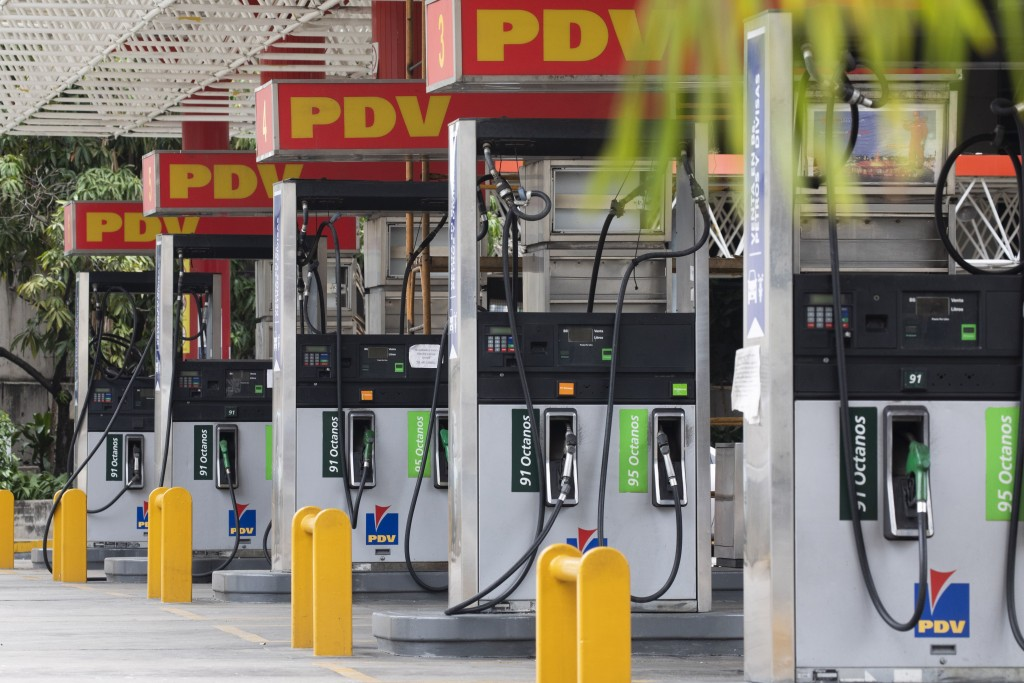 Closed gas pumps stand at a gas station in Caracas, Venezuela, Tuesday, Sept 8, 2020. Gasoline shortages have returned to Venezuela, sparking mile-lon...