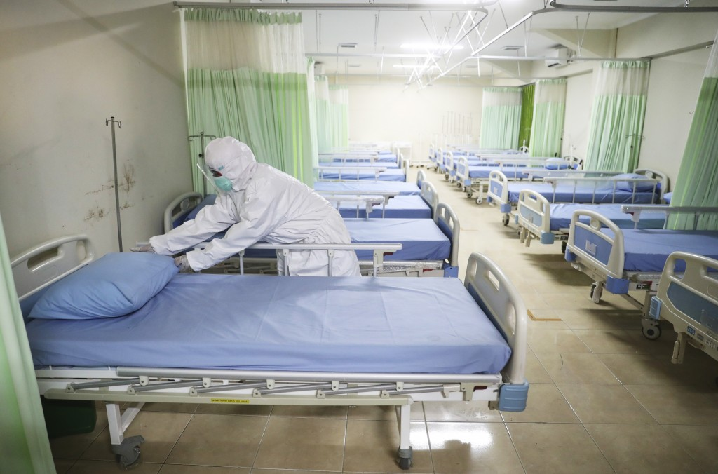A medics inspects makeshift isolation rooms at Patriot Candrabhaga stadium prepared to become a quarantine facility for people showing symptoms of the...