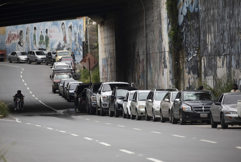 Vehicles line up near a gas station to fill their tanks in Caracas, Venezuela, Tuesday, Sept 8, 2020. Gasoline shortages have returned to Venezuela, s...