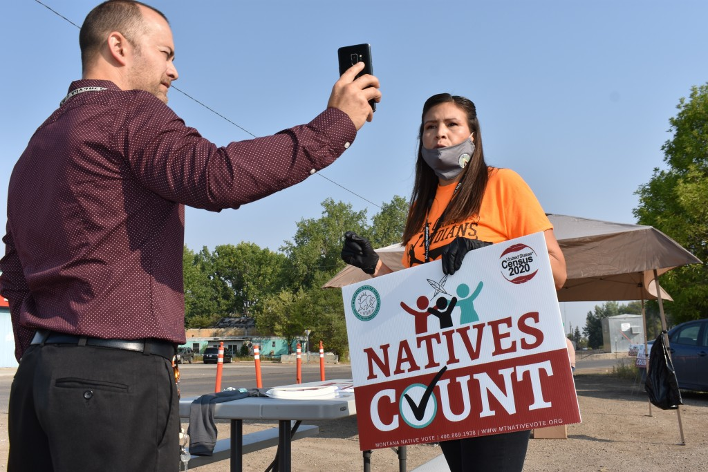 Activist Lauri Dawn Kindness, right, speaks at the Crow Indian Reservation, in Lodge Grass, Mont. on Wednesday, Aug. 26, 2020, as Lodge Grass Mayor Qu...