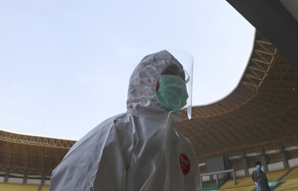 A medic walks at Patriot Candrabhaga stadium to make one of the rooms at the stadium a quarantine facility for people showing symptoms of the COVID-19...