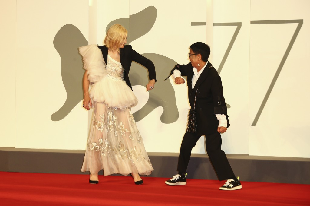 Director Ann Hui, right, and Jury President Cate Blanchett greet one another by touching elbows upon arrival at the red carpet for the Lifetime Achiev...