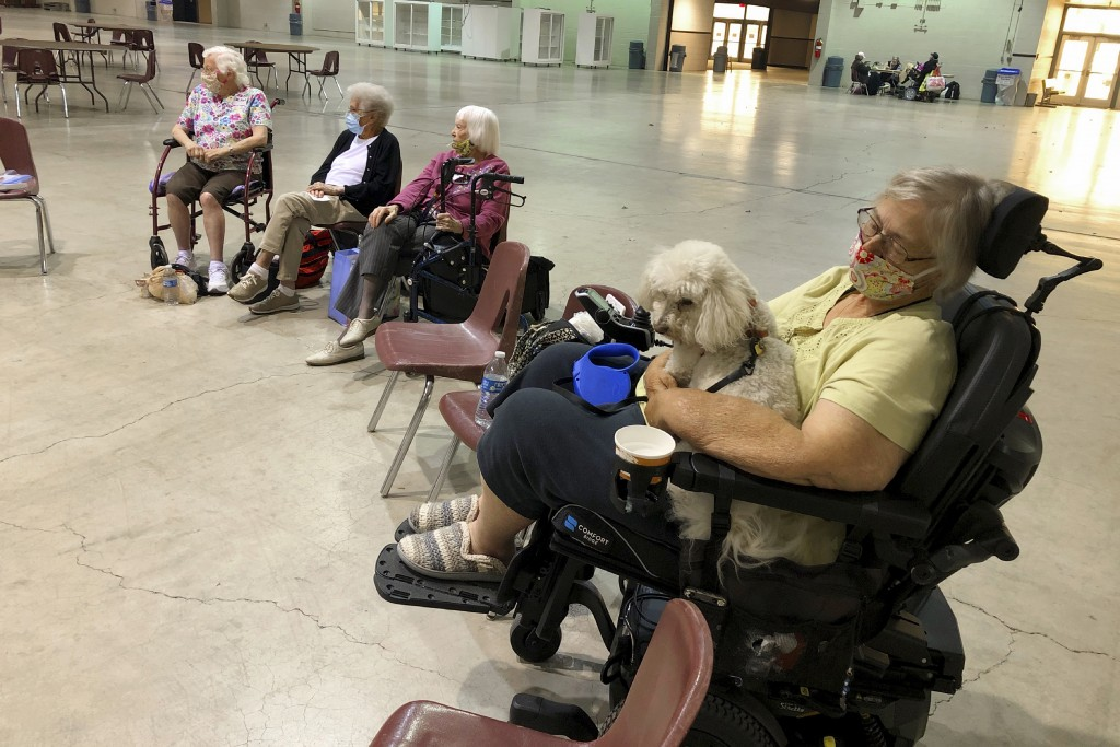 CORRECTS SPELLING OF SENIOR LIVING HOME TO MARIAN ESTATES INSTEAD OF MARION ESTATES - Patricia Fouts, 73, sits with her dog Murphy and other evacuated...