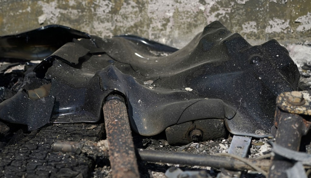 Melted glass from the back window of a truck is shown, Tuesday, Sept. 8, 2020, after a wildfire destroyed homes and outbuildings in Graham, Wash., ove...