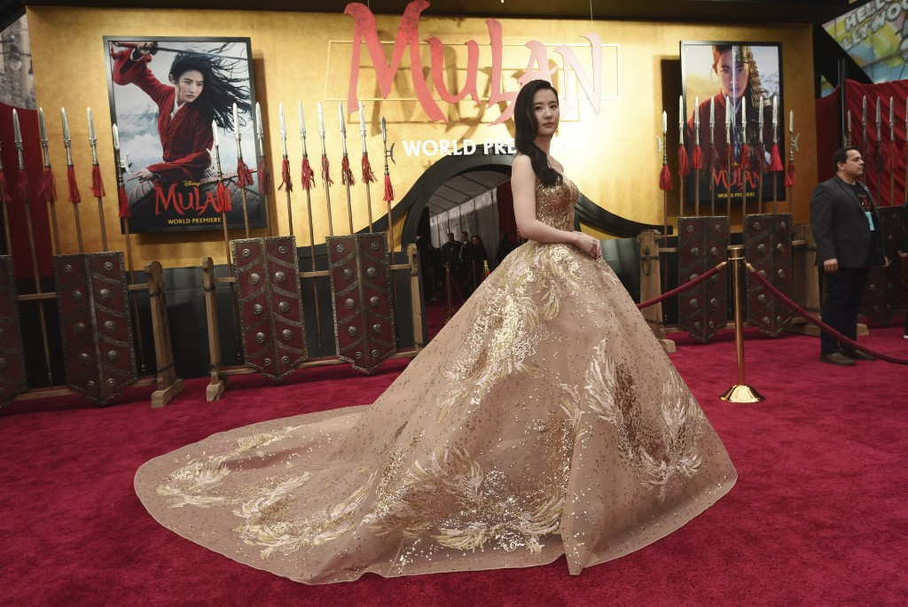 """FILE - In this March 9, 2020, file photo, Yifei Liu, star of the new live-action """"Mulan,"""" poses at the premiere of the film at the El Capitan Theatre ..."""