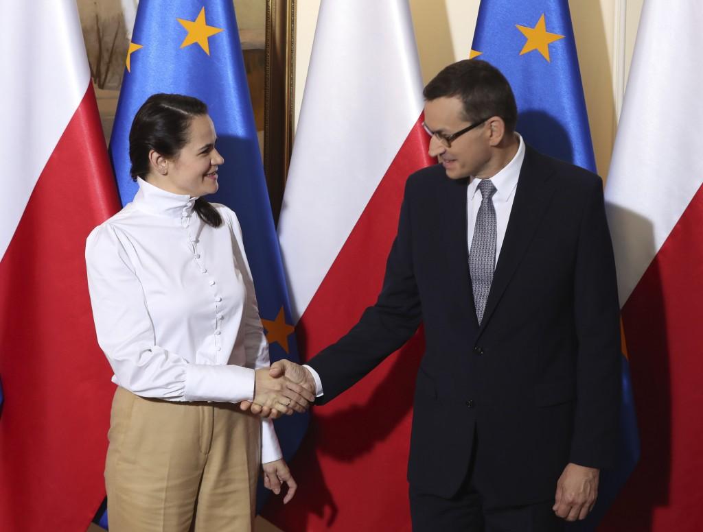 Polish Prime Minister Mateusz Morawiecki ,right, and Belarusian opposition leader Sviatlana Tsikhanouska ,left, shake hands during an official welcome...