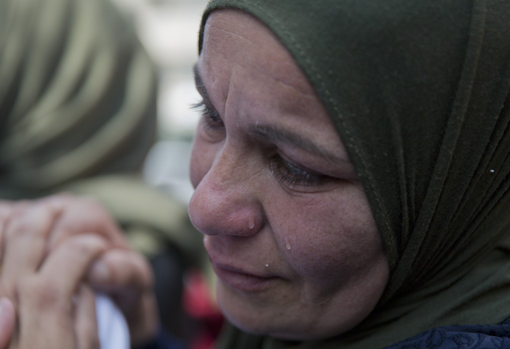 FILE - In this March 21, 2019 file photo, a relative of Palestinian Ahmad Manasra cries during his funeral in the West Bank village of Wad Fokin, near...