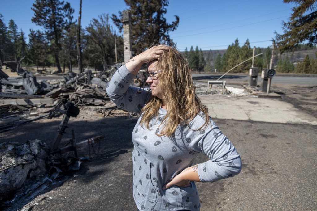 """Hollie Jordan surveys her father's service station that was destroyed by a wildfire on Tuesday, Sept. 8, 2020, in Malden, Wash. """"This was filled with ..."""