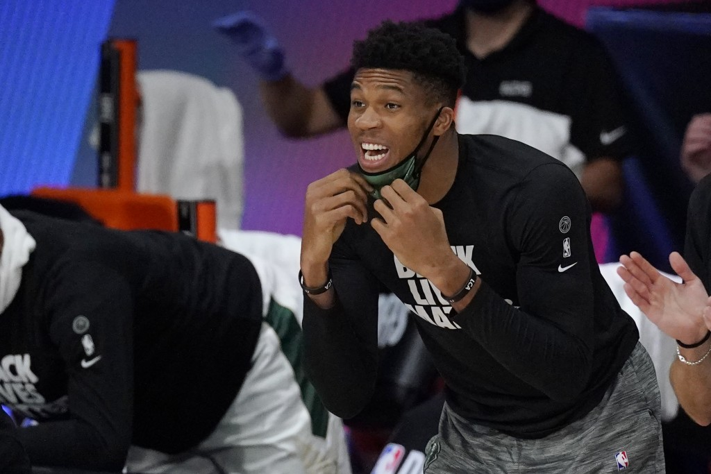 Milwaukee Bucks' Giannis Antetokounmpo shouts from the bench in the second half of an NBA conference semifinal playoff basketball game against the Mia...