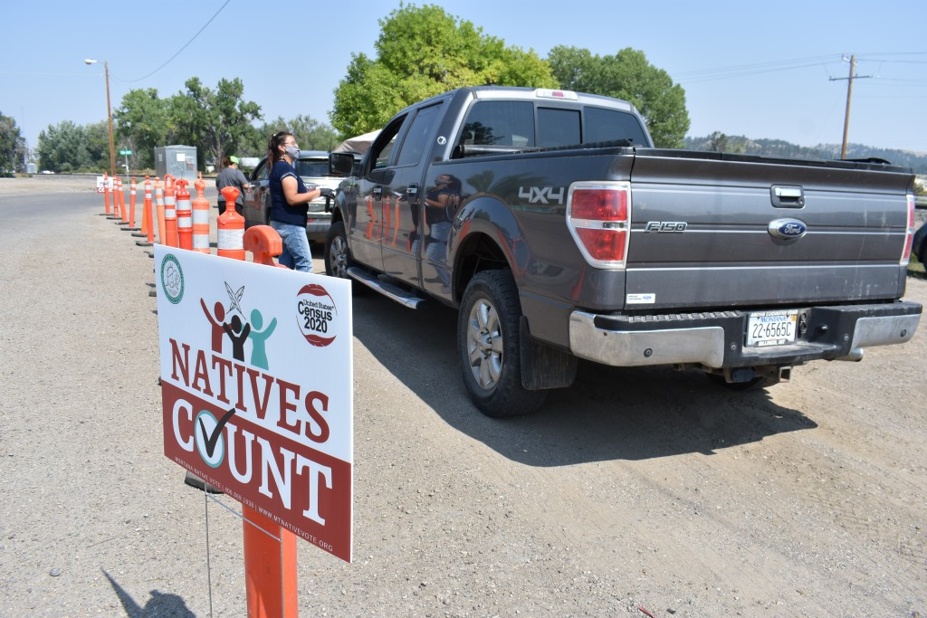Vehicles stop at a drive-thru U.S. Census participation campaign organized by Montana Native Vote on the Crow Indian Reservation in Lodge Grass, Mont....