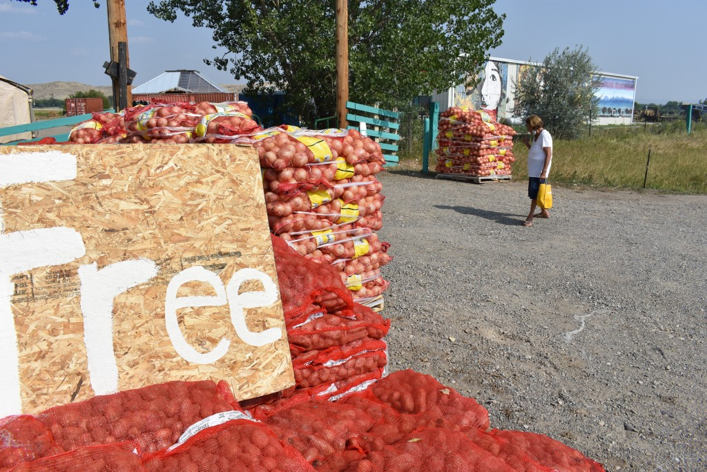 Sacks of onions and potatoes are given away by the non-profit organization Center Pole at the Crow Indian Reservation north of Garryowen, Mont. on Wed...