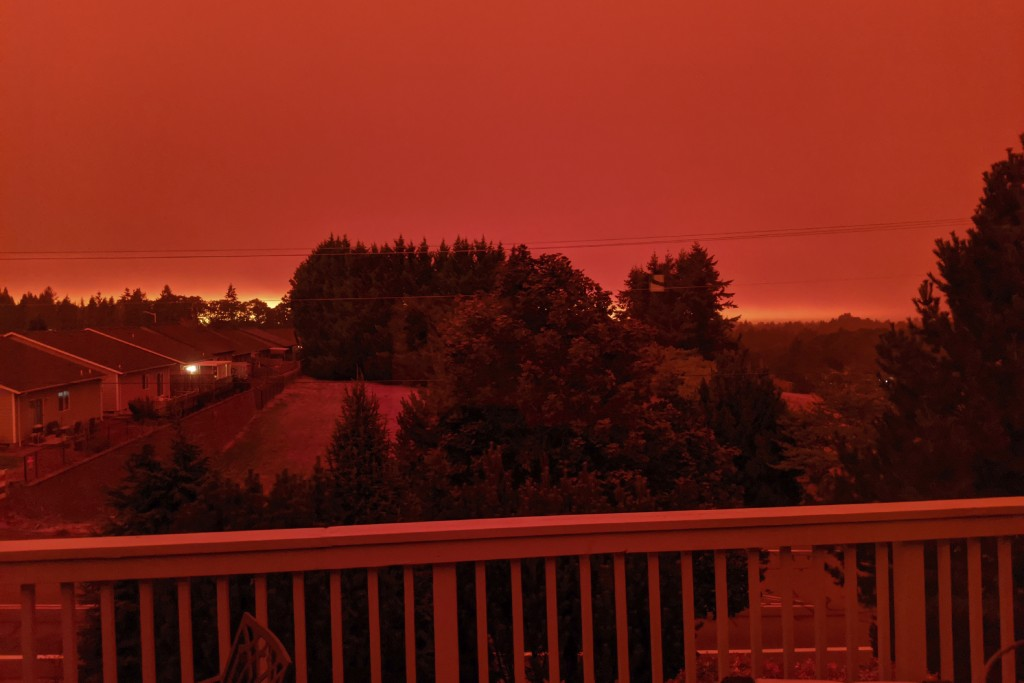 This photo taken from the home of Russ Casler in Salem, Ore., shows the smoke-darkened sky well before sunset at around 5 p.m., Tuesday, Sept. 8, 2020...
