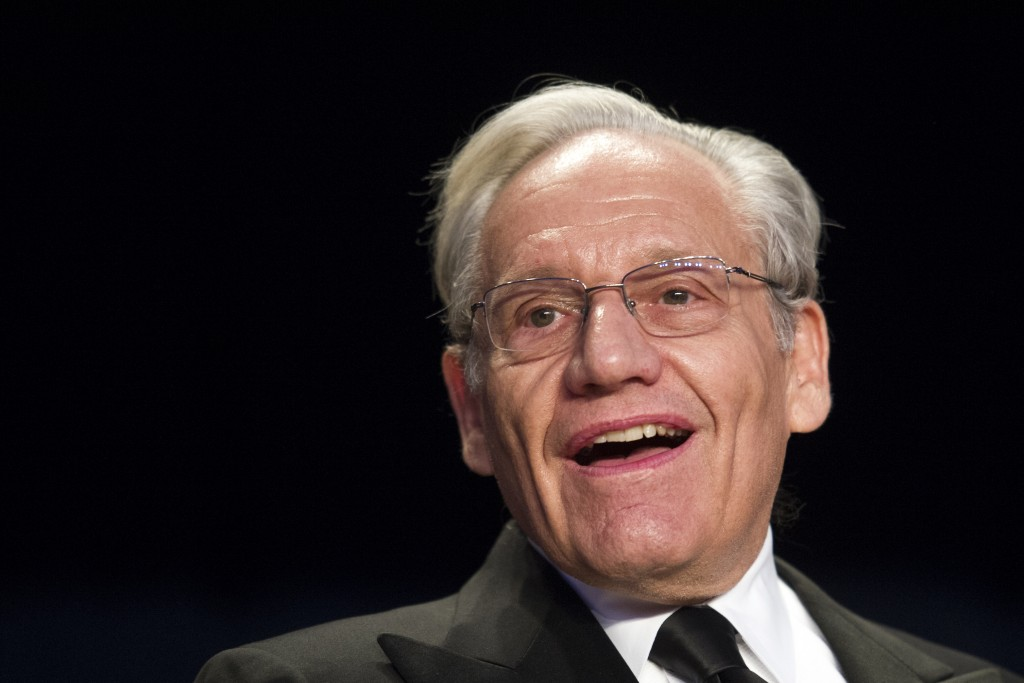FILE - In this April 29, 2017, file photo journalist Bob Woodward sits at the head table during the White House Correspondents' Dinner in Washington. ...