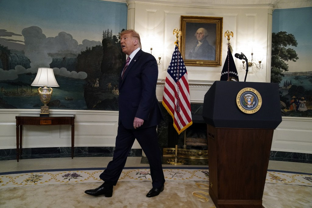 President Donald Trump leaves after speaking at an event on judicial appointments, in the Diplomatic Reception Room of the White House, Wednesday, Sep...