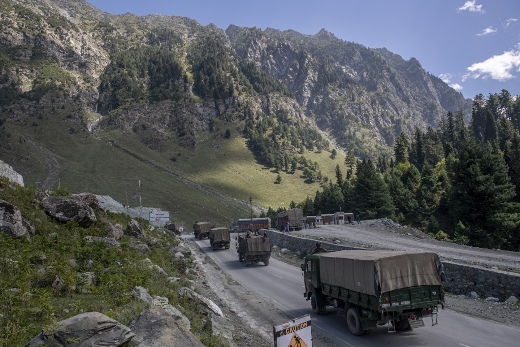 An Indian army convoy moves on the Srinagar- Ladakh highway at Gagangeer, northeast of Srinagar, Indian-controlled Kashmir, Wednesday, Sept. 9, 2020. ...
