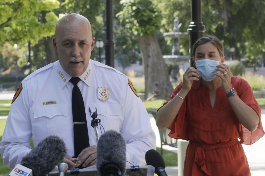 FILE - In this Aug. 3, 2020 file photo, Salt Lake City police Chief Mike Brown speaks as Mayor Erin Mendenhal listens during a news conference on Aug....