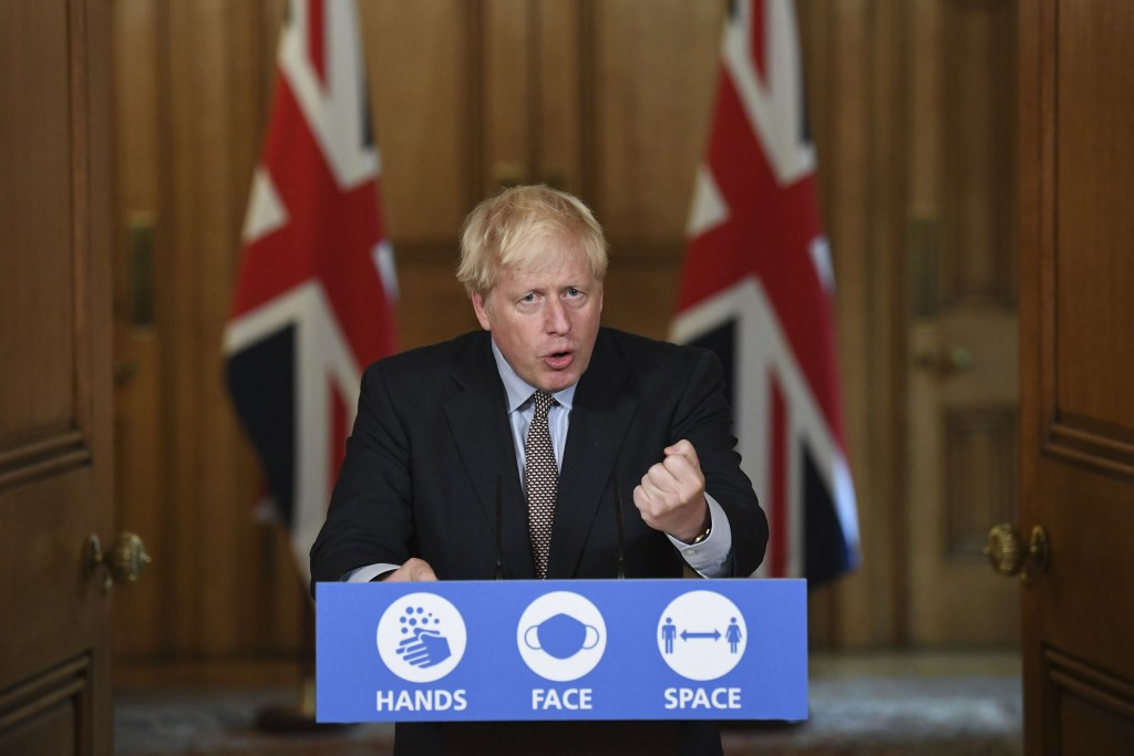 Britain's Prime Minister Boris Johnson speaks during a virtual press conference at Downing Street, London, Wednesday Sept. 9, 2020, following the anno...