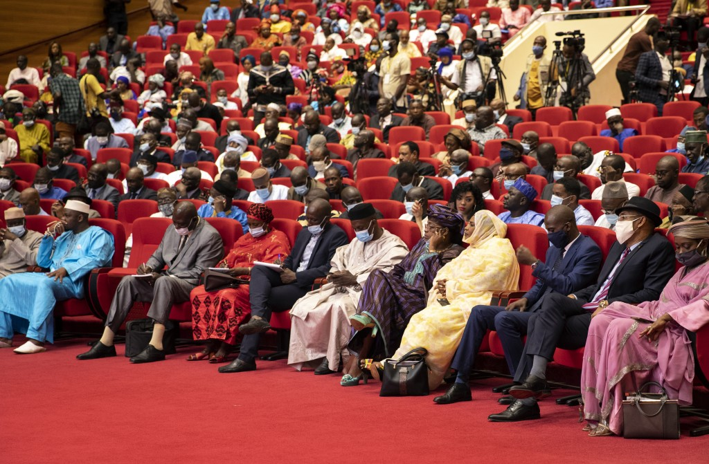 Delegates attend a conference to discuss a transition to a civilian government in Bamako, Mali, Thursday, Sept. 10, 2020. Leaders of Mali's military j...