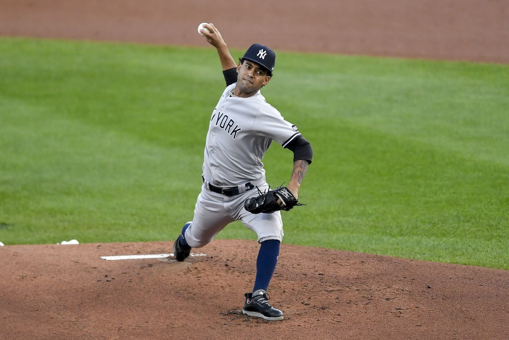 New York Yankees starting pitcher Deivi Garcia throws to a Toronto Blue Jays batter during the first inning of a baseball game in Buffalo, N.Y., Wedne...