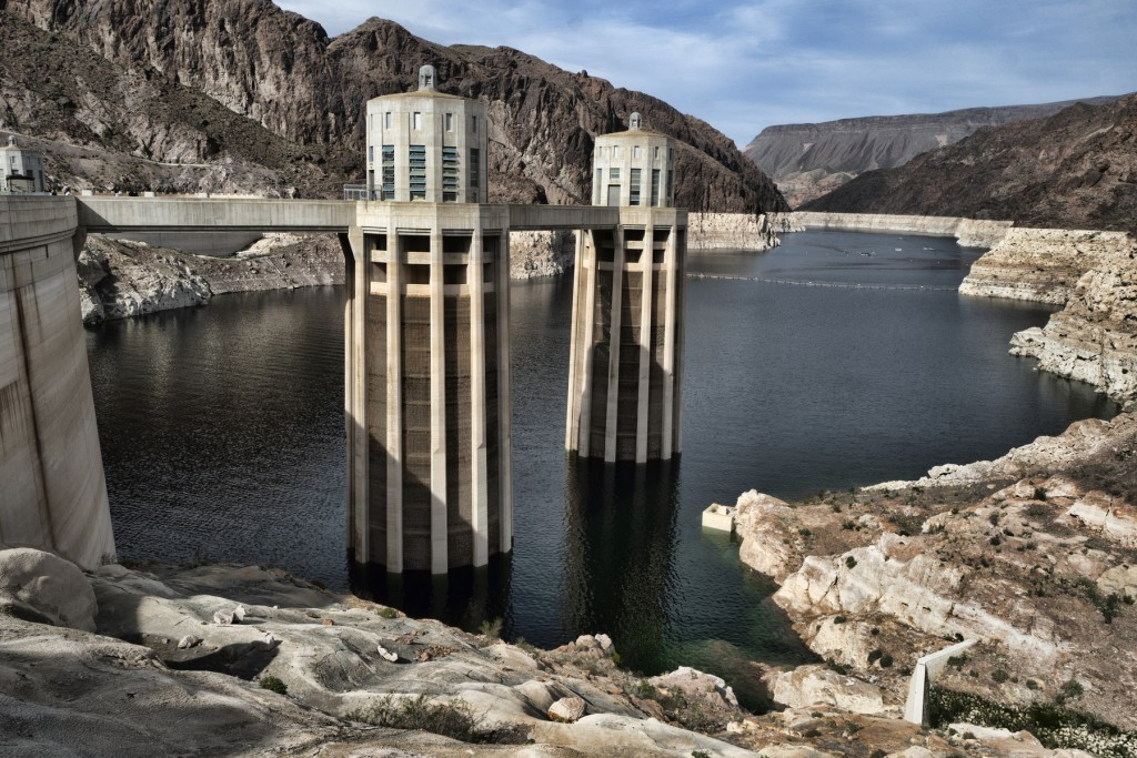 FILE - This March 26, 2019, file photo, shows a bathtub ring of light minerals showing the high water mark of the reservoir which has shrunk to its lo...