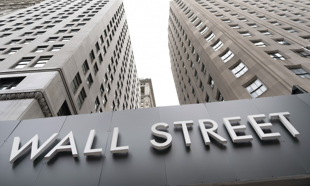 FILE - In this Aug. 31, 2020 file photo, buildings line Wall Street, in New York.  Stocks are ticking higher in early Wednesday, Sept. 16,  trading on...