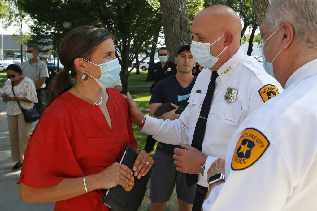 FILE  - In this Aug. 3, 2020 file photo, Salt Lake City Mayor Erin Mendenhal and Salt Lake City police Chief Mike Brown speak following a news confere...