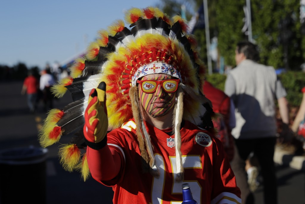 In this Feb. 2, 2020 file photo, a Kansas City Chiefs fan walks outside the stadium before the NFL Super Bowl 54 football game between the San Francis...