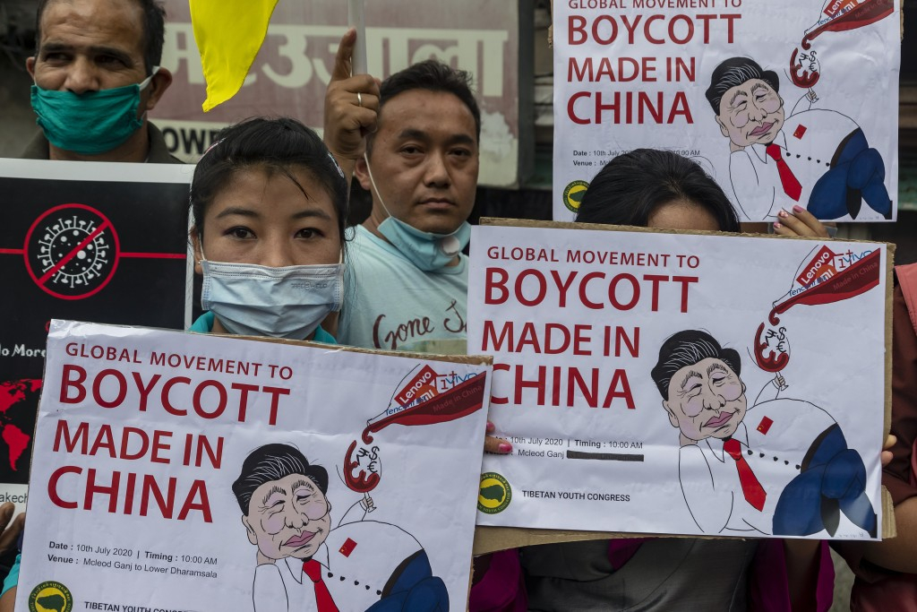 FILE- In this July 10, 2020 file photo, members of the Tibetan Youth Congress participate in a street protest calling for the boycott of Chinese goods...