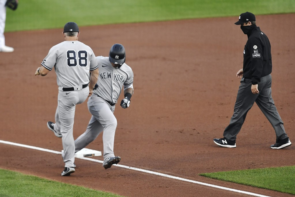 New York Yankees' Gleyber Torres celebrates with third base coach Phil Nevin (88) after hitting a solo home run against the Toronto Blue Jays during t...
