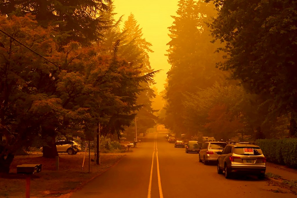 In a photo provided by Christian Gallagher, a street in West Linn, Ore., is shrouded by smoke from wildfires, Thursday, Sept. 10, 2020. (Christian Gal...